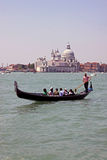 Gondolier, gondola and tourists in Venice Stock Photography