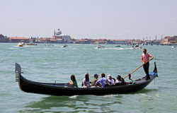 Gondolier, gondola and tourists in Venice Stock Photos