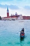 Gondolier on gondola in Venice Royalty Free Stock Image