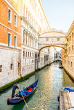 Gondolier with gondola in Venice Stock Photos