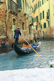 Gondolier on Grand canal Stock Images
