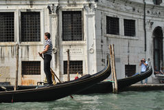 Gondolier on the Grand Canal in Venice, Italy Royalty Free Stock Photography