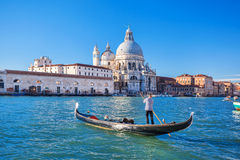 Gondolier on Grand canal in Venice, Italy Stock Photography