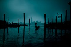 Gondolier in the mystical night royalty free stock photography