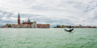 Gondolier near the island of San Giorgio Maggiore, Venice Royalty Free Stock Images