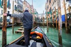 Gondolier parking gondola Royalty Free Stock Photo