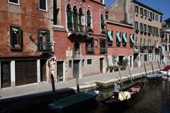 Gondola with gondolier and people in venice italy Stock Images