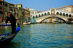 Gondolier with Ponto di Rialto Royalty Free Stock Image