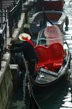 Gondolier preparing boat for tourists,Venice royalty free stock image