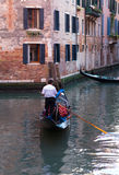 Gondolier in Quiet Venice Canal Stock Photo