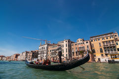 Gondolier rides gondola on the Grand Canal in Venice, Italy Stock Image