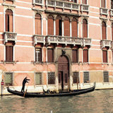 Gondolier rides gondola on the Grand Canal, Venice Stock Photos