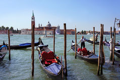 Gondolier rides gondola on Grand canal, Venice Stock Images