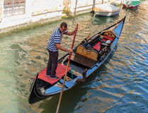 Gondolier rides gondola. Royalty Free Stock Photo