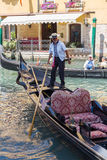 Gondolier rides gondola. Stock Photos