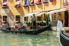 Gondolier rides gondola. Royalty Free Stock Photography