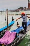 Gondolier rides gondola. Stock Image