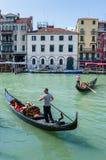 Gondolier rides gondola. Royalty Free Stock Images