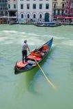 Gondolier rides gondola. Royalty Free Stock Image