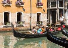 Gondolier rides gondola. Royalty Free Stock Photos