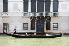 Gondolier rowing and busy with telephone call Royalty Free Stock Photography