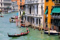Gondolier rowing gondola with tourists on Grand Canal in Venice, Stock Photos