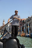 Gondolier rowing gondola in Venice Stock Photography