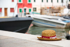 Gondolier's hats in Venice. Traditional straws gondolier's hats in Venice. Straw hat with red ribbon royalty free stock images