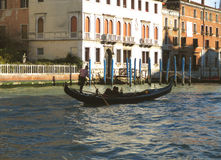 Gondolier Sailing a Gondola against Venetian Style Building On Grand Canal, Venice Royalty Free Stock Image