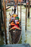 Gondolier sails with tourists sitting in a gondola, Venice, Ital Royalty Free Stock Photo