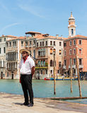 Gondolier standing on the pier Royalty Free Stock Photos