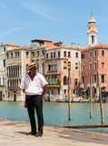 Gondolier standing on the pier Royalty Free Stock Photography