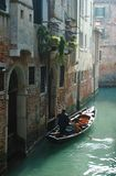 Gondolier taking tourists on Venice canals royalty free stock photos