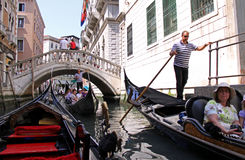 Gondolier and tourists in a gondola Royalty Free Stock Images