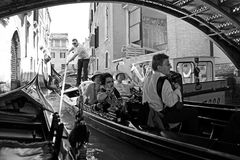 Gondolier and tourists in a gondola royalty free stock photo