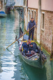 Gondolier with tourists on gondolas Stock Photo
