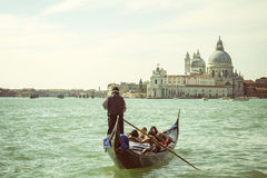 Gondolier with tourists in Venice Royalty Free Stock Image