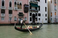 Gondolier in Venice. Boat and gondolier singing in Venice, Italy Royalty Free Stock Images