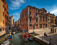 Gondolier waiting for tourists near his Gondolas in Venice, Ital Royalty Free Stock Photos