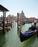 The gondolier is waiting for tourists in the Venice lagoon. Royalty Free Stock Image