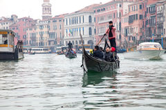 Gondoliero sailing in Venice Grand channel Stock Image