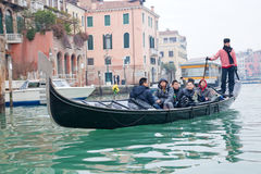 Gondoliero sailing in Venice Grand channel Stock Photo
