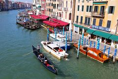 Gondoliers and Gondola boats on Venetian canals in Venice, Italy Royalty Free Stock Image