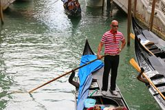 Gondoliers and Gondola boats on Venetian canals in Venice, Italy Royalty Free Stock Photo