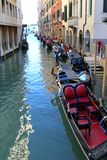 Gondoliers and Gondola boats on Venetian canals in Venice, Italy Royalty Free Stock Photography