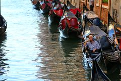 Gondoliers and Gondola boats on Venetian canals in Venice, Italy Royalty Free Stock Photos