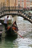 Gondoliers and Gondola boats on Venetian canals in Venice, Italy Stock Image