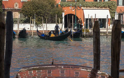 Gondoliers on the Grand Canal. Venice,Italy- February 18, 2012: Gondoliers doing activities in their gondolas on the Grand Canal during the Venice Carnival days Royalty Free Stock Photos