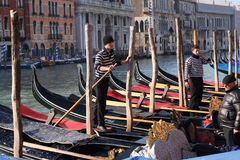 Gondoliers on the Grand Canal in Venice, Italy Stock Images