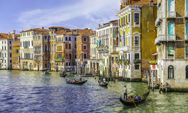Gondoliers in grand canal Royalty Free Stock Image
